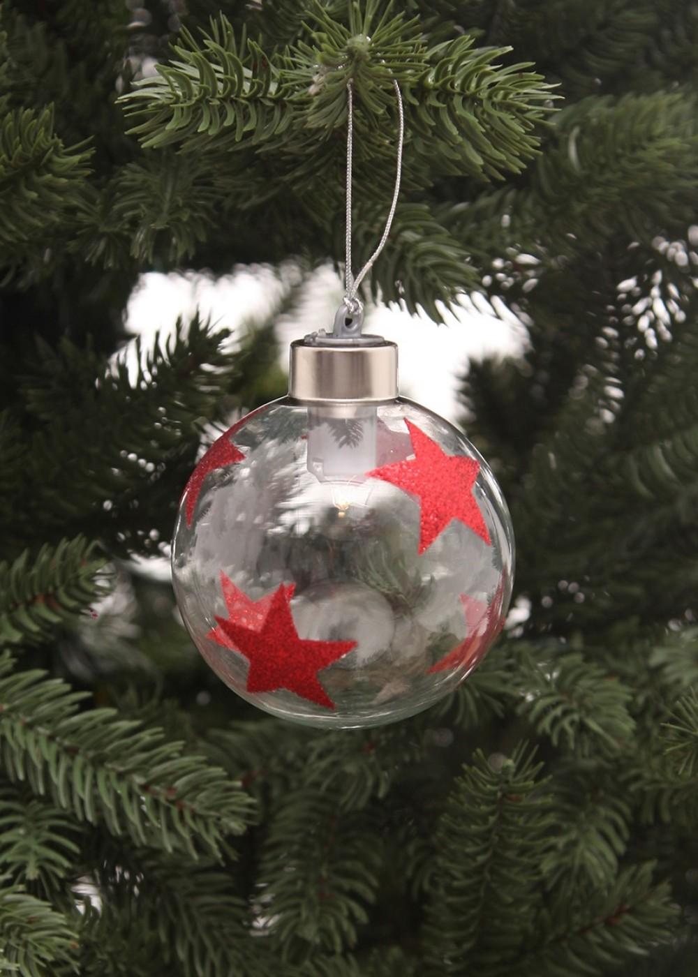 Karácsonyi üveggömb piros csilagokkal